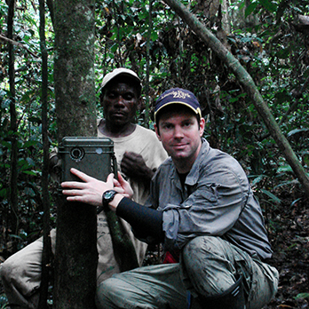 Zoo scientists setting up a motion-activated field camera in the African rainforest